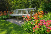 depositphotos_11378063-Wooden-bench-and-bright-blooming